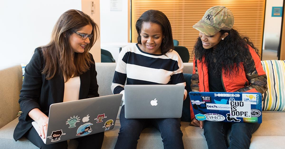 Black women with computers, 3 young girls working smiling